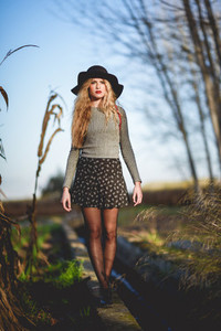 Beautiful young blonde woman in rural background