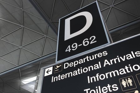 Departures gate sign at modern airport terminal at London Stanst