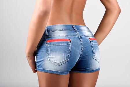 Woman wearing denim shorts with a beautiful waist