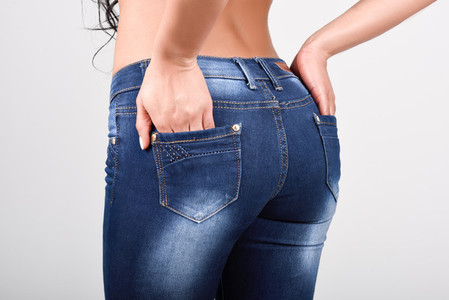 Woman wearing blue jeans with a beautiful waist