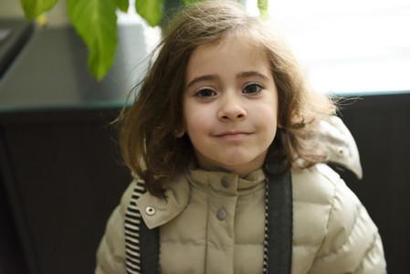Little girl prepared for the return to school