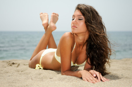 Woman with beautiful body on a tropical beach
