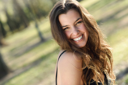 Beautiful woman smiling in a urban park