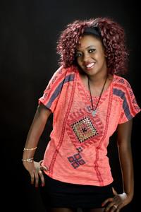 Beautiful black woman on black background  Studio shot