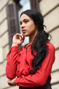 Hispanic stewardess in urban background