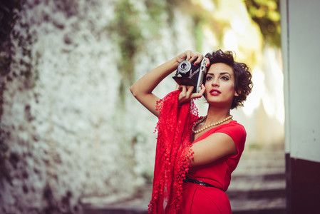 Beautiful woman in urban background Vintage style