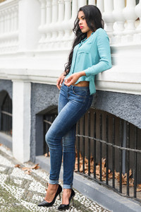 Hispanic young woman wearing casual clothes in urban background