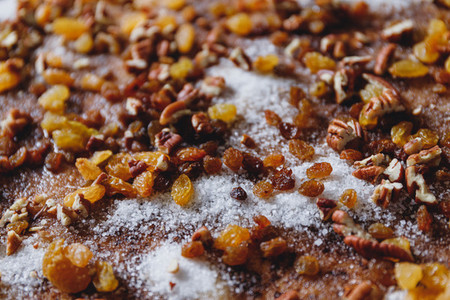 Close up of pie filling ingredients with traditional winter spices like raisins  pecan  cinnamon and sugar