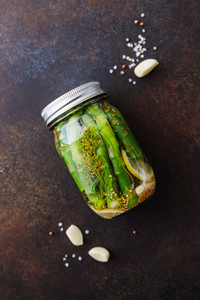 Top view of pickled asparagus in a jar  Seasonal canning vegetable recipe