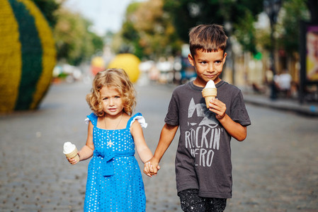 little boy and little girl with ice cream