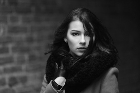 Charming fashion female model in a coat