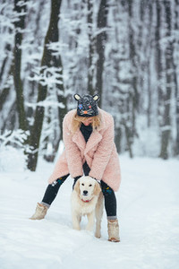 Happy smiling young woman with white dog