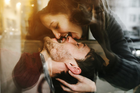 Vintage couple  Girl kiss her boyfriend from above  Coffee sho