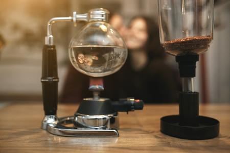 Vintage couple preparing coffee with vacuum coffee maker Coffee