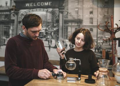 Vintage couple preparing coffee with vacuum coffee makerCoffee