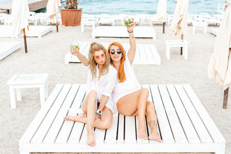 two beautiful girls drinking and have fun