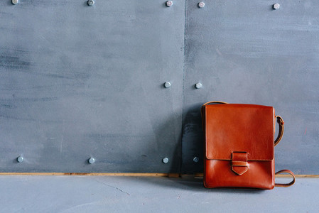man brown leather bag