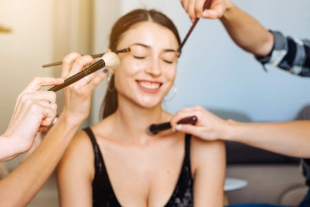 cute  young girl doing makeup