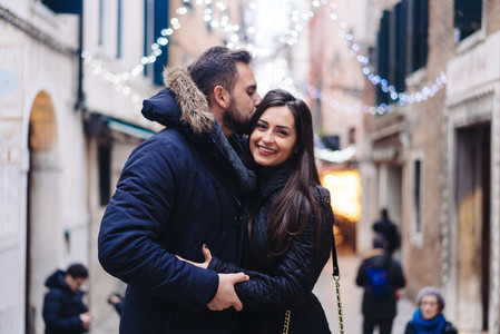 Guy and attractive girl are standing together on street