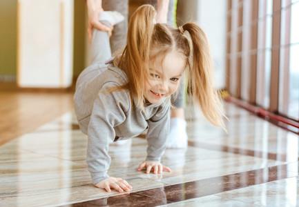Little girl crawls on her hands