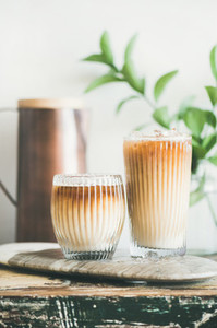Iced coffee drink in tall glasses with milk  close up