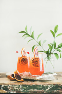 Aperol Spritz alcohol cocktail with orange and ice in glasses