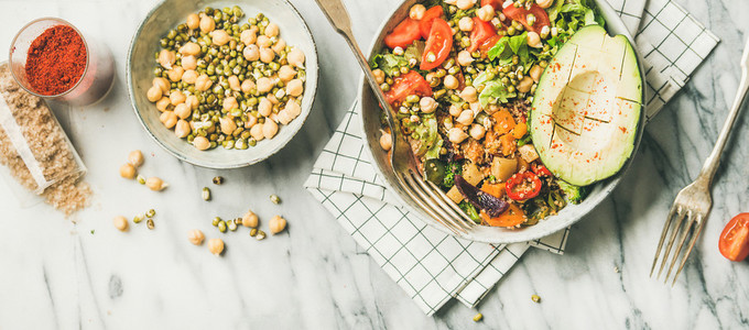 Vegan dinner bowl with avocado  grains  beans and fresh vegetables