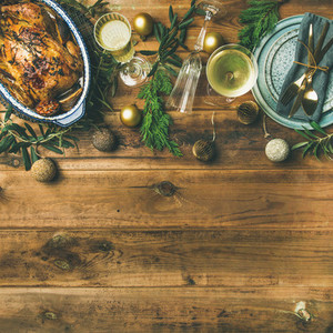 Holiday celebration table setting over rustic wooden background