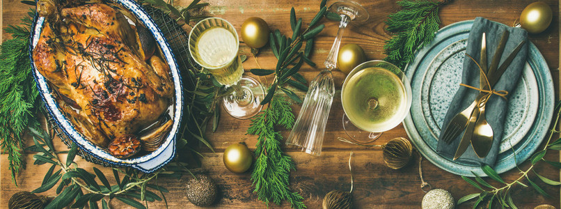 Holiday celebration table setting over rustic wooden background  wide composition