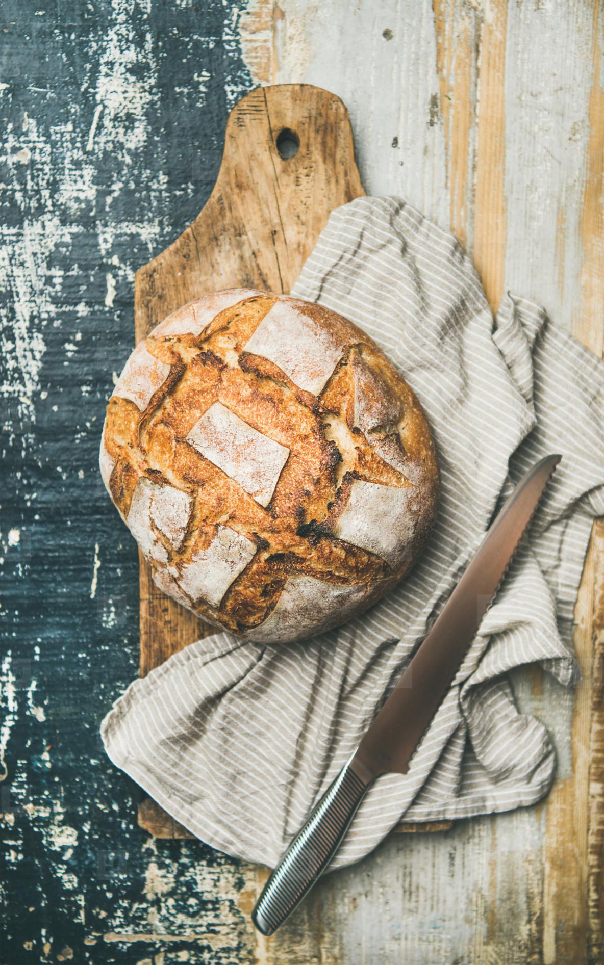 Flat lay of sourdough wheat bread over linen napkin