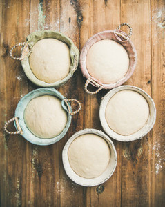 Sourdough for baking homemade bread in baskets  vertical composition