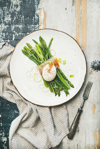Healthy breakfast with green asparagus  soft boiled egg   bacon