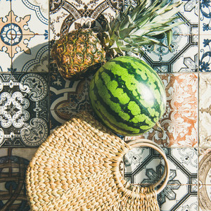 Summer lifestyle background with fruits and straw bag square crop