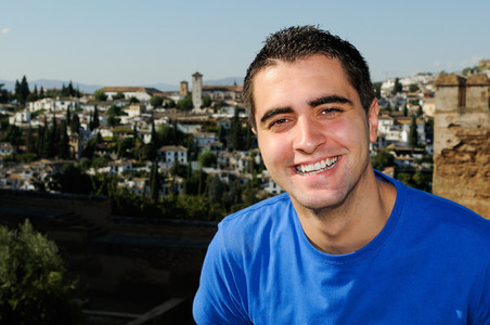 Attractive smiling man portrait in urban background