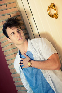 Attractive young man with a nice watch