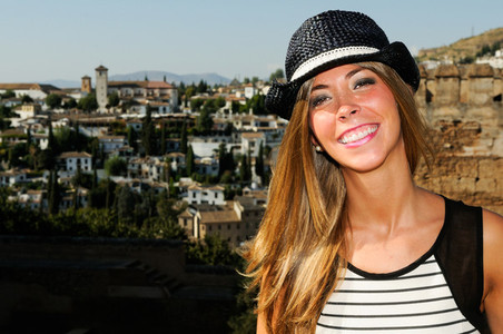 Attractive smiling blonde woman with sun hat