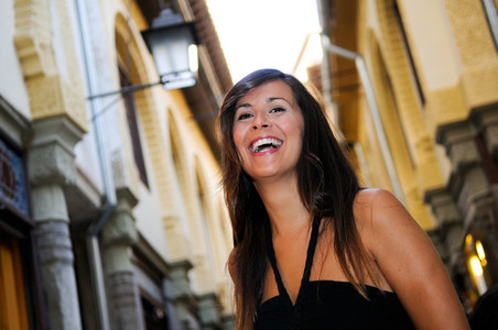 Attractive smiling woman portrait in urban background