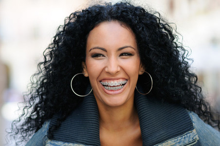 Young black woman smiling with braces