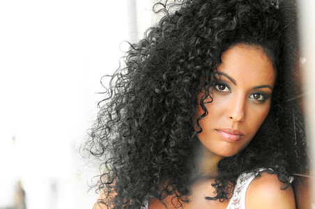 Young black woman  afro hairstyle  in urban background
