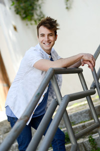 Attractive young man smiling in urban background