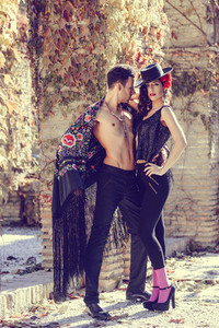 Beautiful couple  models of fashion  wearing spanish clothes
