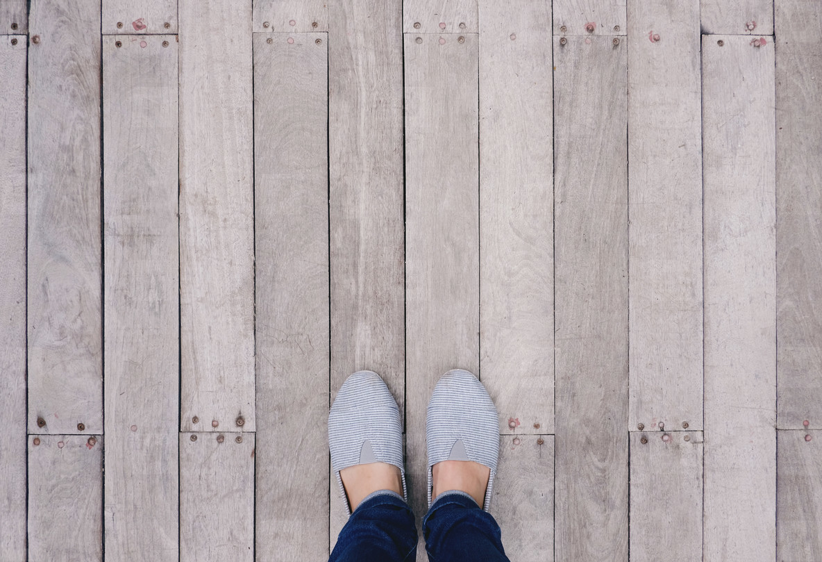 Selfie of feet and shoes on wooden floor