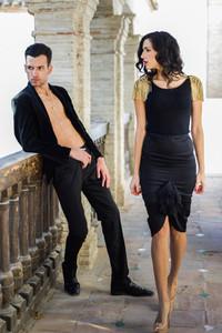 Beautiful couple models of fashion wearing spanish clothes