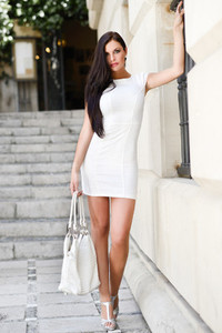 Beautiful woman with bag in the street