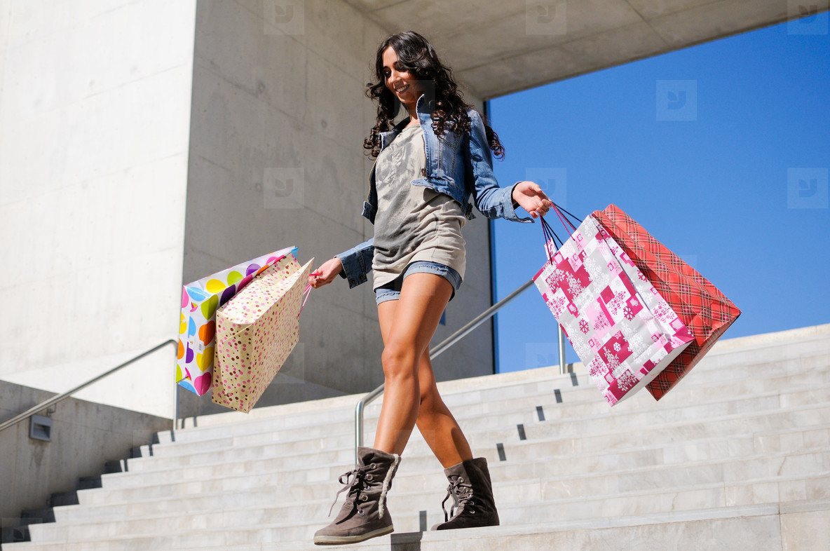 Attractive young girl with shopp