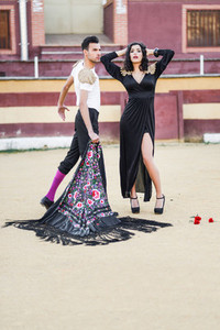 Couple  models of fashion  in a bullring
