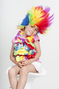 Funny little girl in disguise with wig
