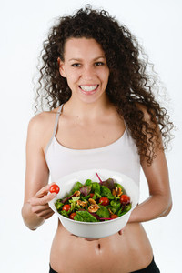 Beautiful young mixed woman with salad  isolated on white