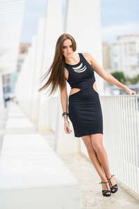 Young woman wearing black dress with long hair