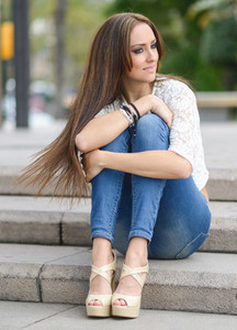 Young woman  wearing casual clothes  with long hair